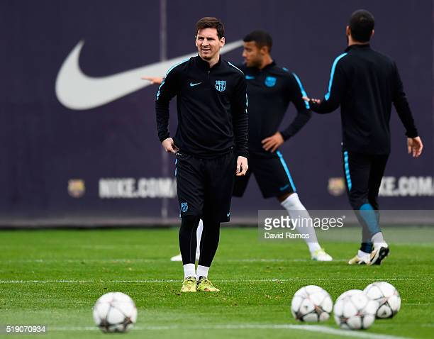 Lionel Messi looks on during a Barcelona training session ahead of their UEFA Champions League quarter final first leg match against Atletico Madrid...
