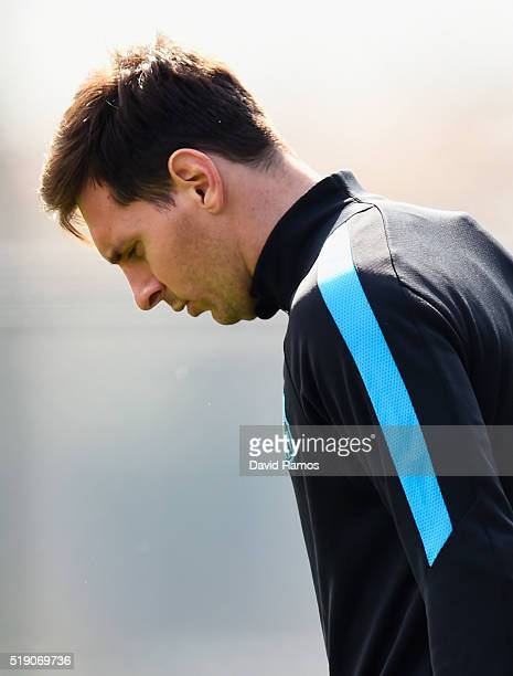 Lionel Messi looks thoughtful during a Barcelona training session ahead of their UEFA Champions League quarter final first leg match against Atletico...