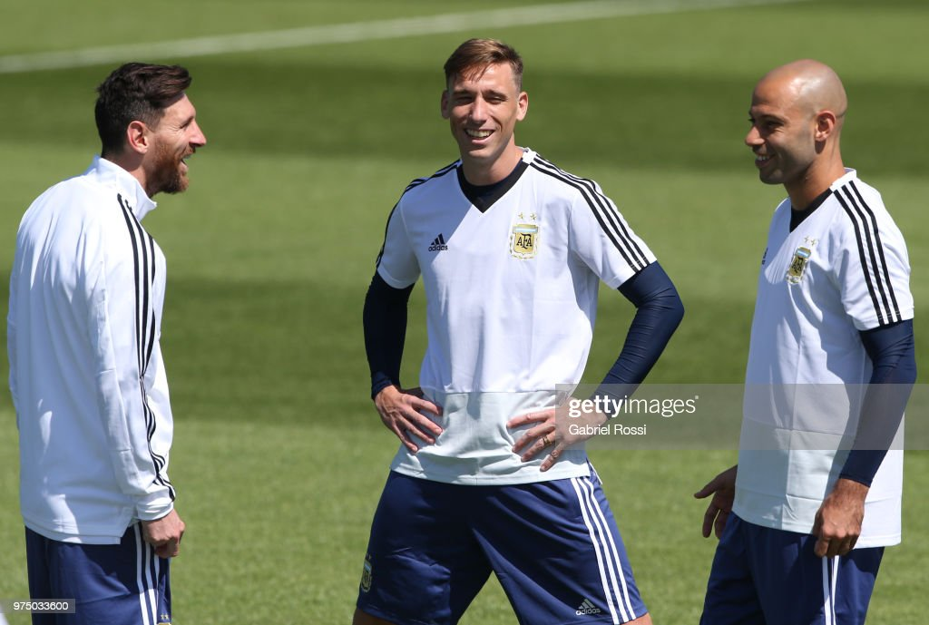 Lionel Messi, Lucas Biglia and Javier Mascherano of Argentina talk prior the last training session before their first game of the FIFA World Cup 2018 at Bronnitsy Training Camp on June 15, 2018 in Bronnitsy, Russia.
