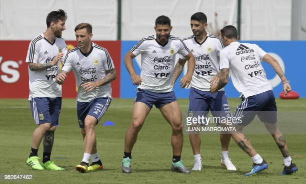 Lionel Messi Lucas Biglia Sergio Aguero Ever Banega and Angel Di Maria attend a training session at the team's base camp in Bronnitsy near Moscow...