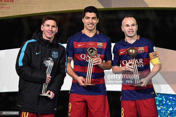 Lionel Messi Luis Suarez and Andres Iniesta hold their respective awards followig the FIFA Club World Cup Japan 2015 Final between River Plate and FC...