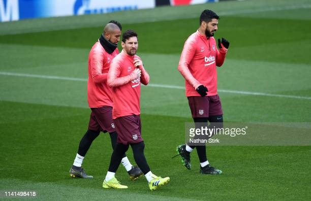 Lionel Messi Luis Suarez and Arturo Vidal of Barcelona during a FC Barcelona training session on the eve of their Champions League Quarter Final...