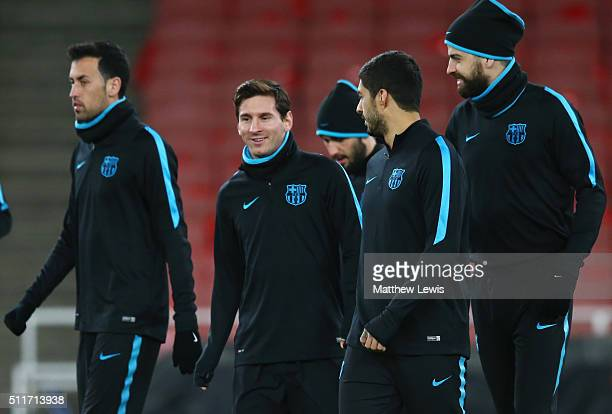 Lionel Messi Luis Suarez and Gerard Pique of Barcelona in discussion during a FC Barcelona training session ahead of their UEFA Champions League...
