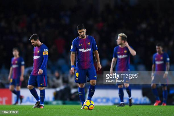 Lionel Messi Luis Suarez and Ivan Rakiti of FC Barcelona react dejected after William Jose of Real Sociedad de Futbol scored the opening goal during...