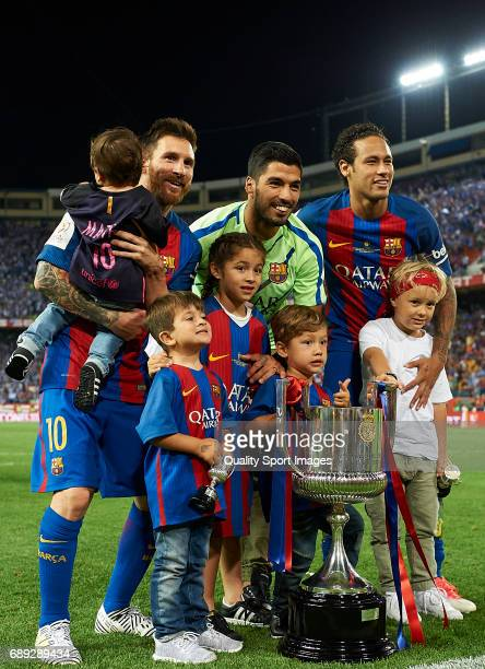 Lionel Messi Luis Suarez and Neymar JR of Barcelona pose with their chlidren after winning the Copa Del Rey Final between FC Barcelona and Deportivo...
