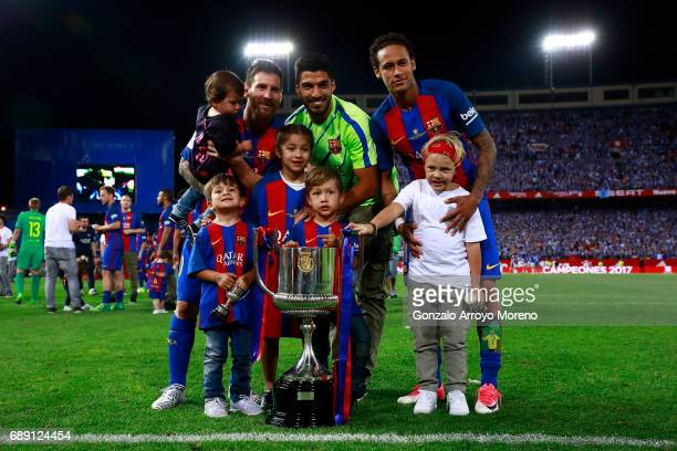 Lionel Messi Luis Suarez and Neymar JR of FC Barcelona and their children pose for a picture with the King's Cup after winning the Copa Del Rey Final...