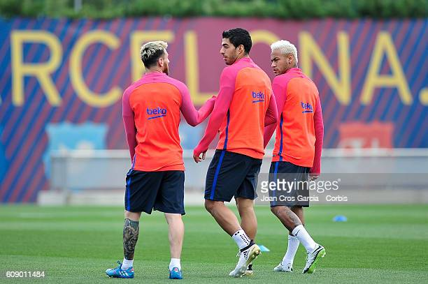 Lionel Messi Luis Suarez and Neymar Jr of FC Barcelona attend a training session at the Sports Center FC Barcelona Joan Gamper before the Spanish...