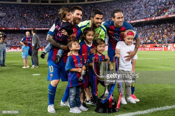 Lionel Messi Luis Suarez Neymar da Silva Santos Junior of FC Barcelona and their sons poses with the trophy after won the Copa Del Rey Final between...