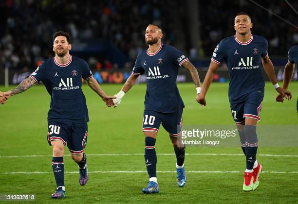 Lionel Messi, Neymar and Kylian Mbappe of Paris Saint-Germain celebrate after victory in the UEFA Champions League group A match between Paris...