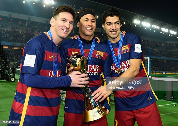 Lionel Messi Neymar and Luis Suarez of Barcelona hold the Winner's Trophy after the FIFA Club World Cup Japan 2015 Final between River Plate and FC...