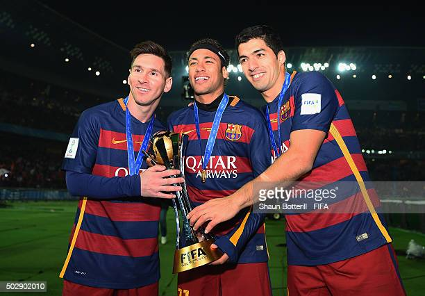 Lionel Messi, Neymar and Luis Suarez of Barcelona hold the Winner's Trophy after the FIFA Club World Cup Final match between River Plate and FC...