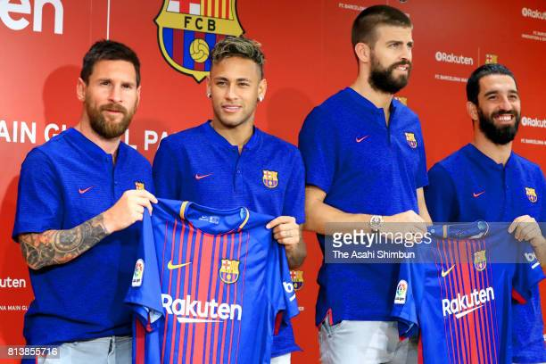 Lionel Messi Neymar Gerard Pique and Arda Turan pose for photographs with the new uniforms during the FC Barcelona And Rakuten Global Partnership...