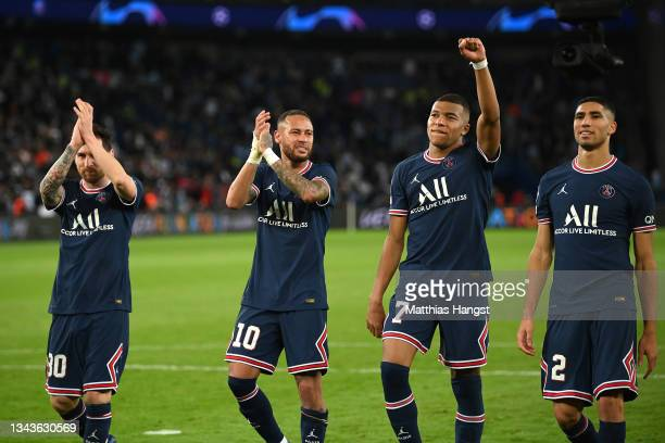 Lionel Messi, Neymar, Kylian Mbappe and Achraf Hakimi of Paris Saint-Germain celebrate after victory in the UEFA Champions League group A match...