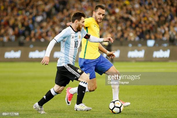 Lionel Messi of Argentia runs with the ball during the Brasil Global Tour match between Brazil and Argentina at Melbourne Cricket Ground on June 9...