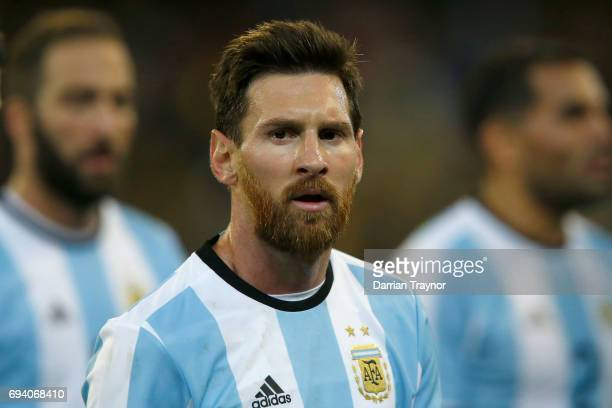 Lionel Messi of Argentia walks from the ground at half time during the Brasil Global Tour match between Brazil and Argentina at Melbourne Cricket...