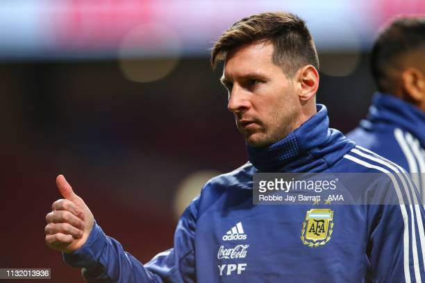 Lionel Messi of Argentina acknowledges the fans as he warms up prior to the International Friendly match between Argentina and Venezuela at Estadio...