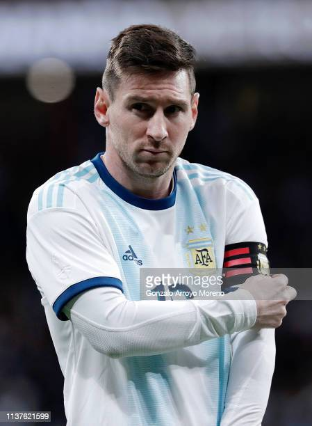 Lionel Messi of Argentina adjusts his captain armband ahead of the International Friendly match between Argentina and Venezuela at Estadio Wanda...