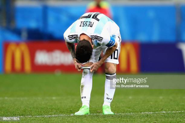 Lionel Messi of Argentina adjusts his socks during the 2018 FIFA World Cup Russia group D match between Argentina and Croatia at Nizhny Novgorod...
