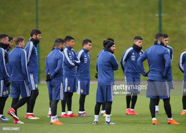 Lionel Messi of Argentina along with team mates look on during a team talk at the start of an Argentina training session at Manchester City Football...