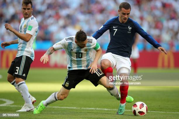 Lionel Messi of Argentina and Antoine Griezmann of France clash as Nicolas Tagliafico of Argentina looks on during the 2018 FIFA World Cup Russia...