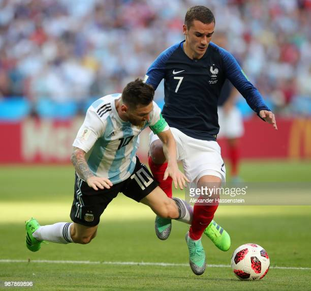 Lionel Messi of Argentina and Antoine Griezmann of France clash during the 2018 FIFA World Cup Russia Round of 16 match between France and Argentina...