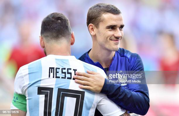 Lionel Messi of Argentina and Antoine Griezmann of France reacts during the 2018 FIFA World Cup Russia Round of 16 match between France and Argentina...