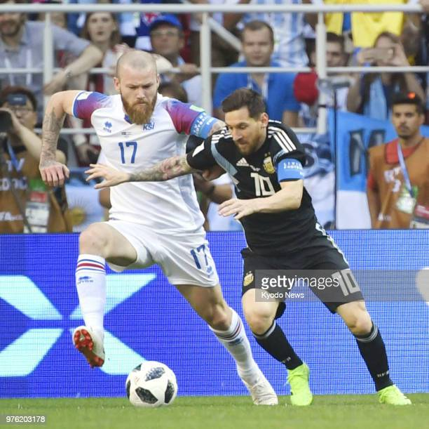 Lionel Messi of Argentina and Aron Gunnarsson of Iceland vie for the ball during the first half of a football World Cup group stage match at Spartak...