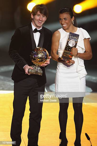 Lionel Messi of Argentina and Barcelona FC winner of the men's player of the year award alongside Marta of Brazil winner of the women's player of the...