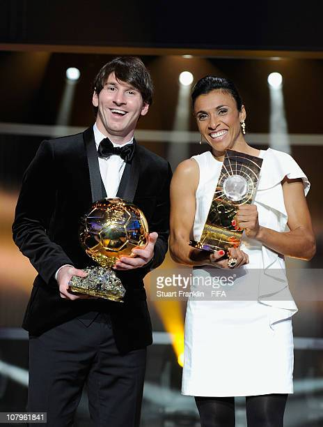 Lionel Messi of Argentina and Barcelona FC with the FIFA player of the year award with Marta of Brazil with the FIFA womens world player of the year...