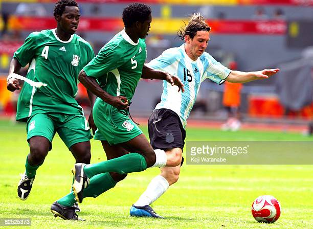 Lionel Messi of Argentina and Dele Adeleye of Nigeria compete for the ball during the Men's Final between Nigeria and Argentina at the National...