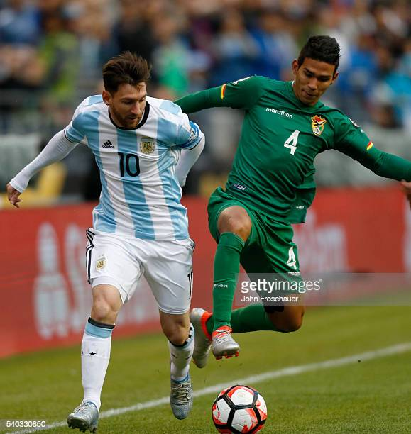 Lionel Messi of Argentina and Diego Bejarano of Bolivia battle for the ball during a group D match between Argentina and Bolivia at CenturyLink Field...