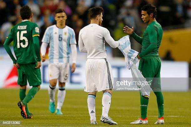 Lionel Messi of Argentina and Diego Bejarano of Bolivia exchange jerseys after the a group D match between Argentina and Bolivia at Century Link...