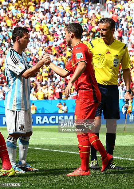 Lionel Messi of Argentina and Eden Hazard of Belgium shake hands prior to the 2014 FIFA World Cup Brazil Quarter Final match between Argentina and...