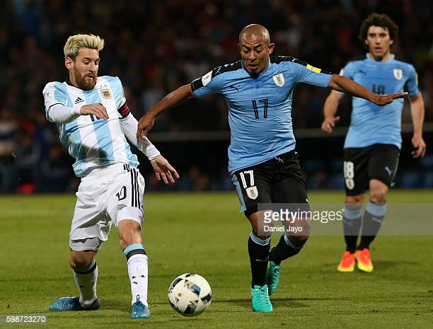 Lionel Messi of Argentina and Egidio Arevalo Rios of Uruguay vie for the ball during a match between Argentina and Uruguay as part of FIFA 2018 World...