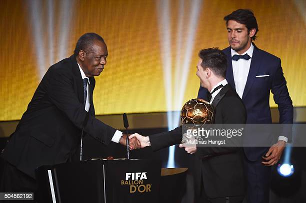 Lionel Messi of Argentina and FC Barcelona receives the Ballon d'or from acting FIFA President Issa Hayatou during the FIFA Ballon d'Or Gala 2015 at...