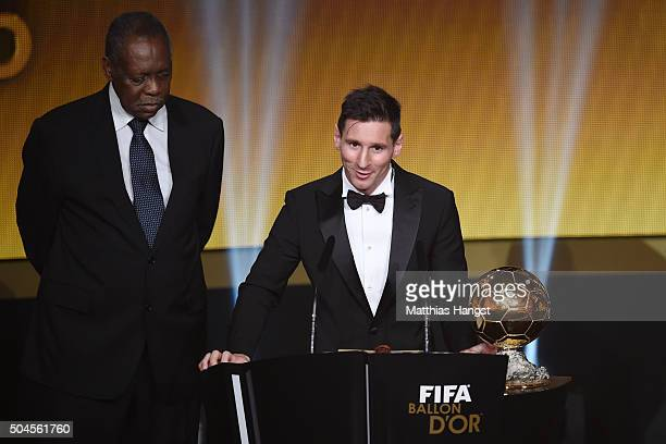 Lionel Messi of Argentina and FC Barcelona speaks to the audience after receiving the Ballon d'or from acting FIFA President Issa Hayatou during the...