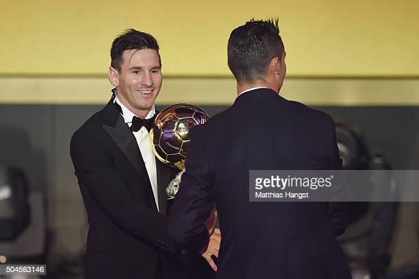 Lionel Messi of Argentina and FC Barcelona the winner of the Ballon d'or is congratulated byCristiano Ronaldo of Portugal and Real Madrid during the...
