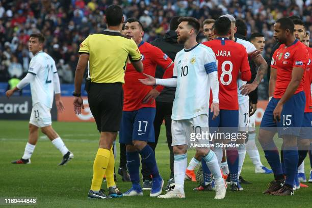 Lionel Messi of Argentina and Gary Medel of Chile argue with Referee Mario Diaz de Vivar after being shown the red card during the Copa America...
