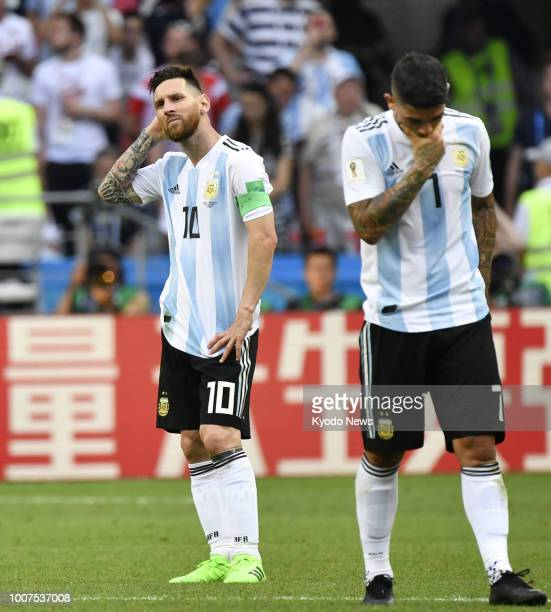 Lionel Messi of Argentina and his teammate Ever Banega look dejected after losing 43 to France in a World Cup roundof16 match against France in Kazan...