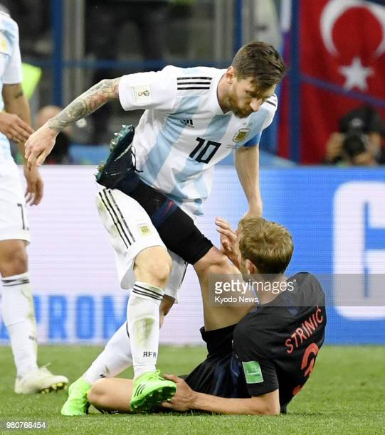 Lionel Messi of Argentina and Ivan Strinic of Croatia clash during the second half of a World Cup group stage match in Nizhny Novgorod Russia June 21...