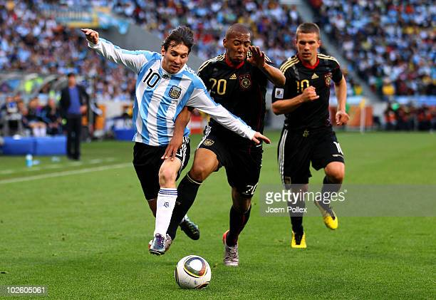 Lionel Messi of Argentina and Jerome Boateng of Germany battle for the ball during the 2010 FIFA World Cup South Africa Quarter Final match between...