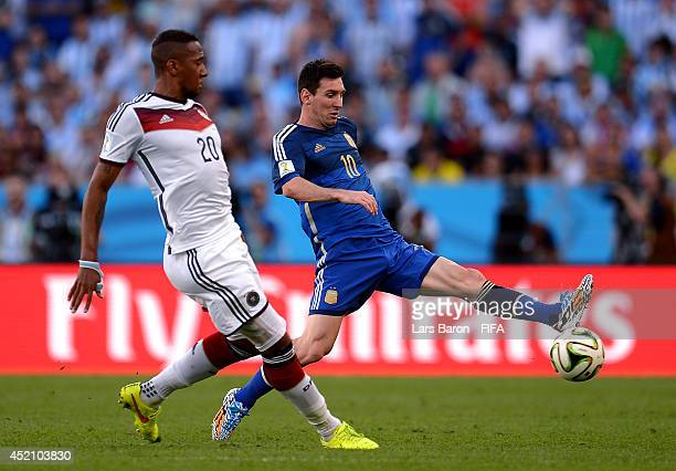 Lionel Messi of Argentina and Jerome Boateng of Germany compete for the ball during the 2014 FIFA World Cup Brazil Final match between Germany and...