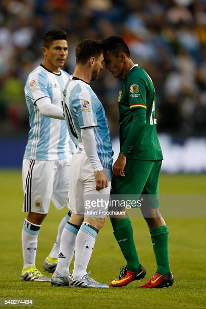 Lionel Messi of Argentina and Jhasmani Campos of Bolivia scuffle during a group D match between Argentina and Bolivia at Century Link Field as part...