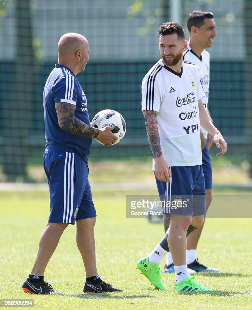 Lionel Messi of Argentina and Jorge Sampaoli coach of Argentina talk during a training session at Stadium of Syroyezhkin sports school on June 28...