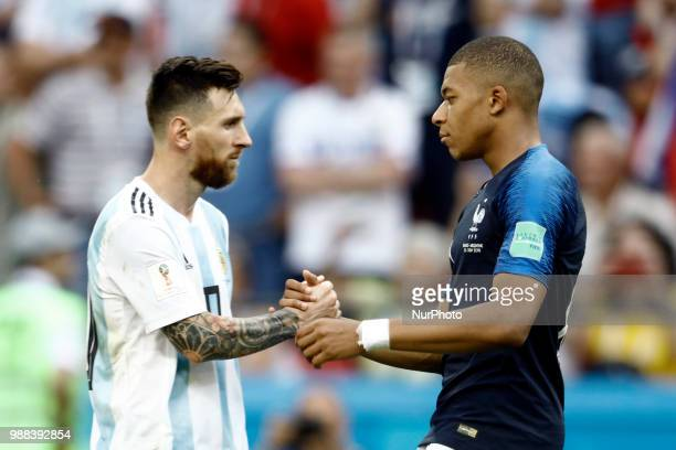 Lionel Messi of Argentina and Kylian Mbappe of France embrace after the 2018 FIFA World Cup Russia Round of 16 match between France and Argentina at...