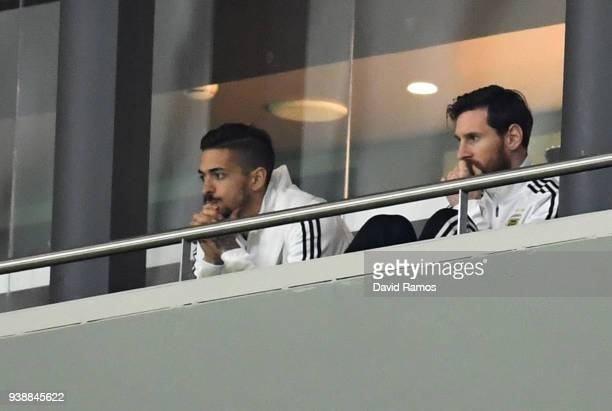 Lionel Messi of Argentina and Manuel Lanzini of Argentina watch from the stands during the International Friendly between Spain and Argentina on...