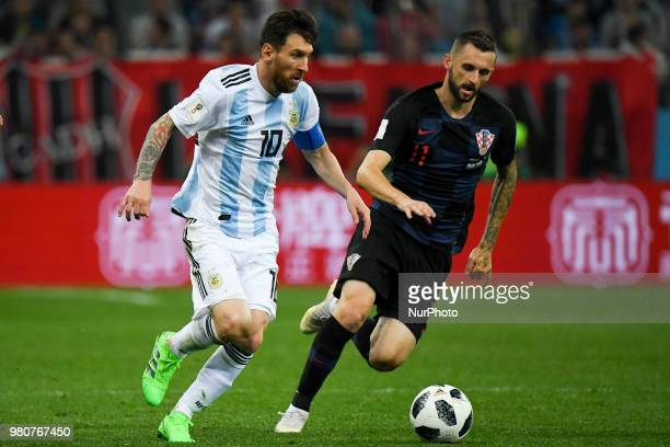 Lionel Messi of Argentina and Marcelo Brozovic of Croatia fight for the ball during the FIFA World Cup Group D match between Argentina and Croatia at...