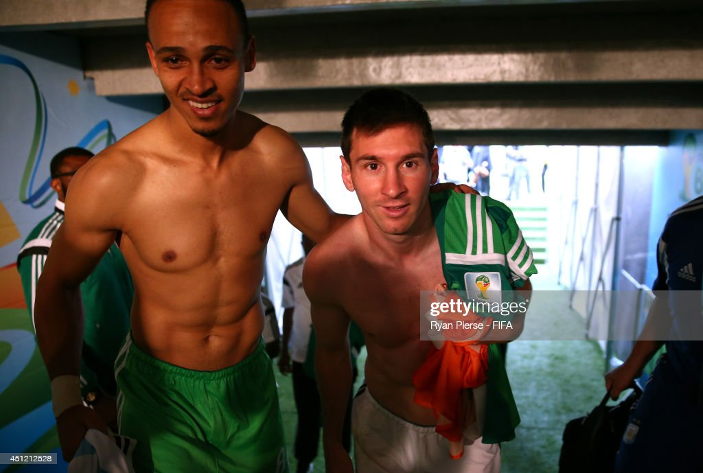Lionel Messi of Argentina and Peter Odemwingie of Nigeria walk in the tunnel after the 2014 FIFA World Cup Brazil Group F match between Nigeria and Argentina at Estadio Beira-Rio on June 25, 2014 in Porto Alegre, Brazil.