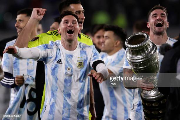 Lionel Messi of Argentina and Rodrigo De Paul of Argentina celebrate with the Copa America trophy after a match between Argentina and Bolivia as part...