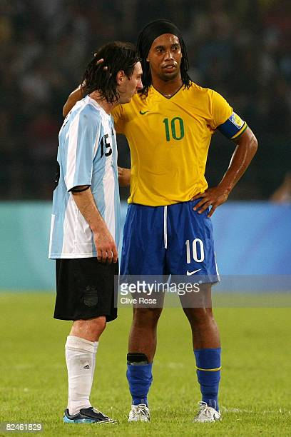 Lionel Messi of Argentina and Ronaldinho of Brazil embrace during the men's football semifinal match between Argentina and Brazil at Workers' Stadium...